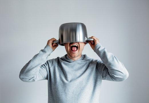 Crying man with pan on head o