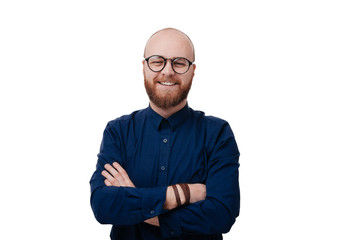 Portrait of happy fashionable bearded man with eyeglassees crossing hands and look at camera over white background