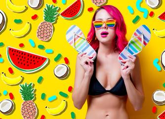 Young pink hair girl in bikini and rainbow glasses