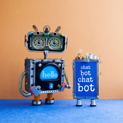Chatbot artificial intelligence poster. Creative design robot and smartphone gadget with message Chat Bot on blue screen. Modern electronic marketing communication concept. Brown wall blue floor