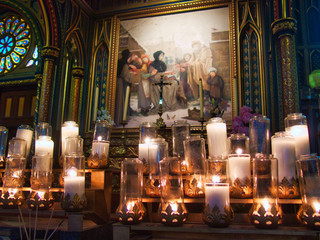 candles in the interior of catholic church