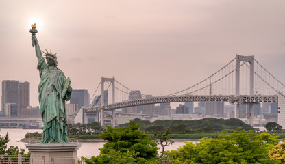Statue of liberty, rainbow bridge and Tokyo cityscape, Japan