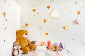 Child dream concept. Cosy bedroom decorated with toys and stars