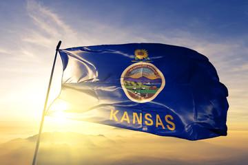 Kansas state of United States flag waving on the top sunrise mist fog Wall mural