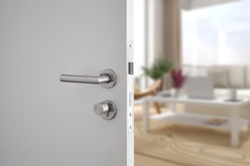 Door handle , door open in front of blur interior room background, selective focus Wall mural