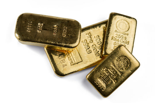 Several gold bars of different weight isolated on white background.