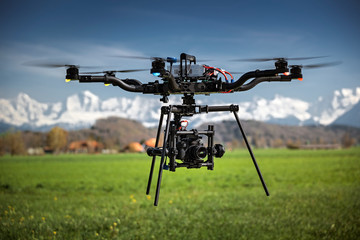 Big professional camera drone in mid-air