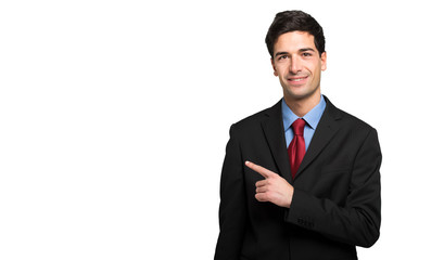 31fbe7ca02c Portrait of a young manager pointing to the left using his index finger