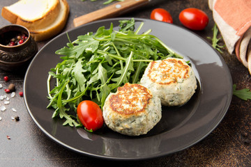 Fried chicken cutlet with herbs, delicious healthy lunch, children's food, diet. Meatballs with salad on dark background