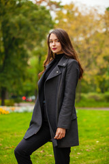 Portrait of a young beautiful woman in gray coat