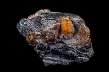 Macro of the mineral stone Columbite, Beryl, Feldspar on a black background