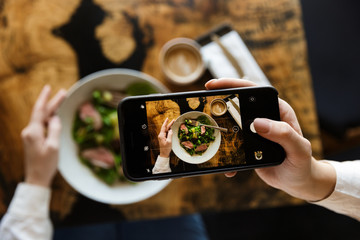 Woman taking a picture of her lunch