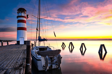 Lighthouse at Lake Neusiedl at sunset with a tourist