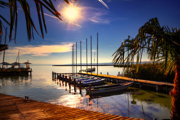 Small harbour at Lake Neusiedl in Austria with Boats and sailing ships. Neusiedl am See is located on the northern shore of the Neusiedler See.
