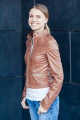 Beautiful young blonde smiling woman wearing casual outdoor