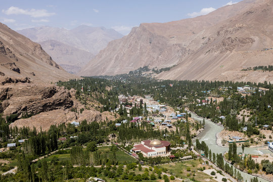 Gunt River with the city of Khorog in the Wakhan valley in Tajikistan with the Pamir mountains