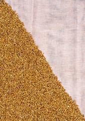 Buckwheat on light cloth, diagonal