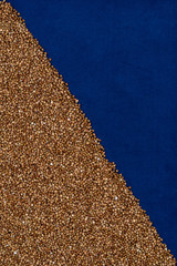 Buckwheat on dark blue cloth, diagonal