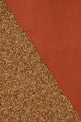 Buckwheat on terra-cotta cloth, diagonal