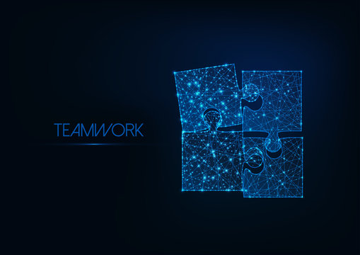 Teamwork concept with four glowing low poly jigsaw puzzle pieces on dark blue background.