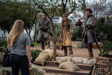 Actors dressed as characters from Game Of Thrones interact with attendees as they walk through an interactive Game Of Thrones installation at the South by Southwest (SXSW) conference and festivals in Austin, Texas