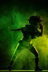 silhouette zumba dancer with smoke background