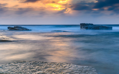 Soft and Cloudy Sunrise Seascape