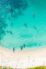 Fototapete - View from above, stunning aerial view of a beautiful tropical beach with white sand and turquoise clear water, long-tail boats and people sunbathing, Banana beach, Phuket, Thailand.