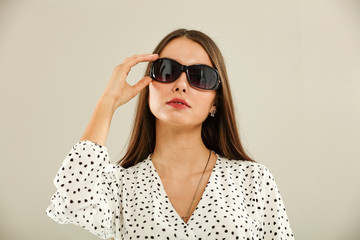 Slim young woman and summer sunglasses