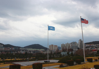 United Nations Flag Waving in the air of UN Memorial Cemetery in Busan, South Korea, Asia