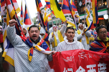 Wu'er Kaixi, a former student leader who escaped to Taiwan after China's 1989 June 4 Tiananmen Square democracy movement takes part in a march to mark the 60th anniversary of Tibetan uprising against Chinese rule, in Taipei