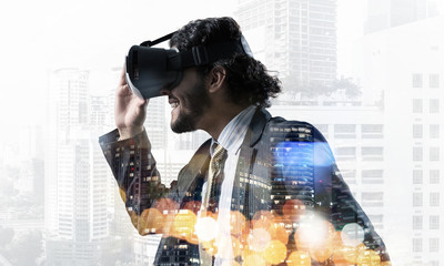 Handsome businessman in bokeh lights experiencing impressive virtual reality technology