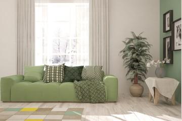 Green stylish minimalist room with sofa. Scandinavian interior design. 3D illustration