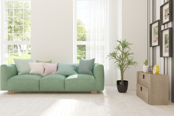 White stylish minimalist room with sofa and summer landscape in window. Scandinavian interior design. 3D illustration