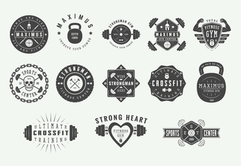 Set of vintage gym fitness logos, emblems, badges, labels, marks and design elements. Retro graphic art. Vector Illustration.
