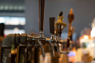 beer disenser many of at the pub bar