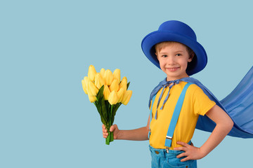 Little boy super hero holding flowers. Mother's Day, Women's Day concept.