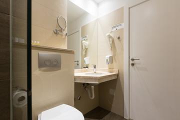 Hotel bathroom interior with shower cabin