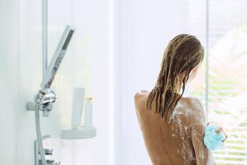 Woman taking bathroom in the morning