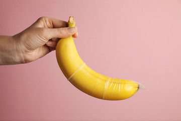 Yellow banana with condom, concept of protected sex.