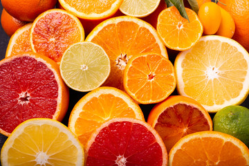 Sliced citrus fruits in the foreground