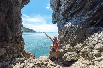 Travel people lifestyle women tourist standing and relax in summertime and vacations in a cave near the sea in Keo Sichang, Thailand. Travel and Trips Concept
