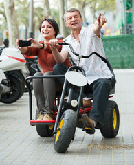 Couple with double bike and camera in vacation