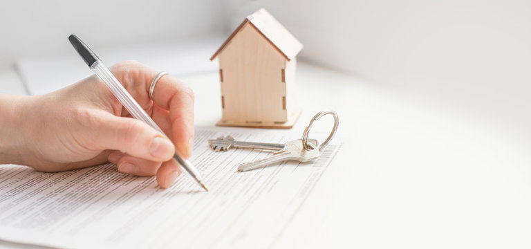 mortgage and housing rent. Keys, house and hand that signs documents