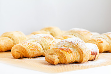 Fragrant and delicious French croissants on the kitchen table