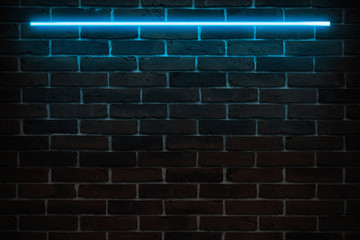 Background texture of empty red brick wall with blue neon light lamp, 80s style glow
