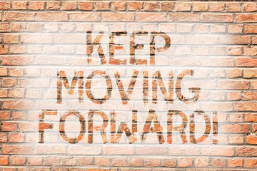 Text sign showing Keep Moving Forward. Business photo text improvement Career encouraging Go ahead be better Brick Wall art like Graffiti motivational call written on the wall