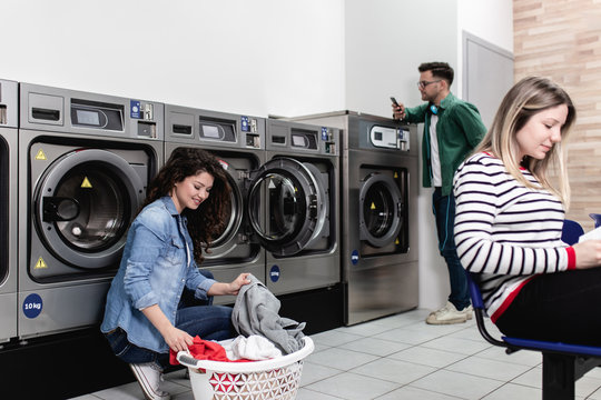Young people at laundromat shop.