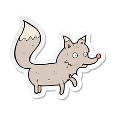sticker of a cartoon wolf cub