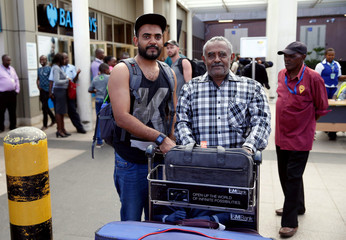Passenger Ahmed Khalid, who missed his Ethiopian Airlines Flight ET 302 while connecting from Dubai, is received by his father Khalid Bzambur at the JKIA in Nairobi